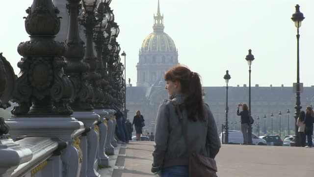 MS Shot of young woman walking at Ponte Alexandre III / Paris, Ile de France, France