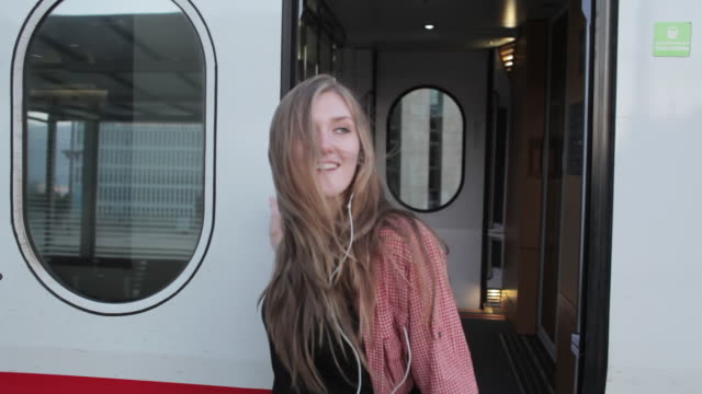 """""""ms shot of young woman with headphones getting off train / berlin, germany"""" - getting out stock videos and b-roll footage"""