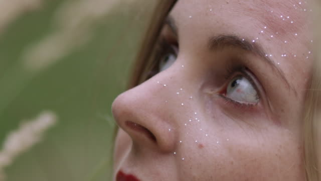 'ECU SLO MO Shot of young woman's face / Berlin, Germany'