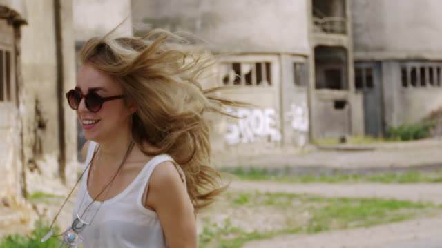 """""""ms ts slo mo shot of young women running and playing outside abandoned building / berlin, germany"""" - board shorts stock videos and b-roll footage"""