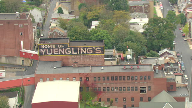 cu aerial zo shot of yuengling brewery building / pottsville, pennsylvania, united states - pottsville pa stock videos & royalty-free footage