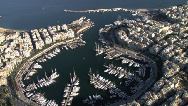 MS AERIAL Shot of Zea marina in Athens with ships and yachts anchored / Athens, Greece