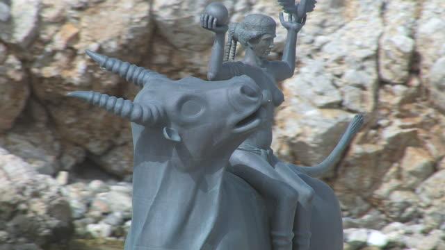 cu aerial shot of zeus statue with europa / agios nikolaos, crete, greece - statue stock videos & royalty-free footage