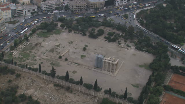 ms aerial zi shot of zeus temple in city / acropolis, athens, greece - zeus stock videos and b-roll footage