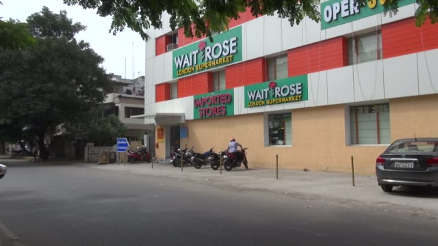 shot on a sunday the original waitrose is a chain of british supermarkets which forms the food retail division of britain's largest employeeowned... - chennai stock videos & royalty-free footage