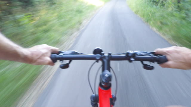 pov shot on bicycle ride along country road - handlebar stock videos & royalty-free footage