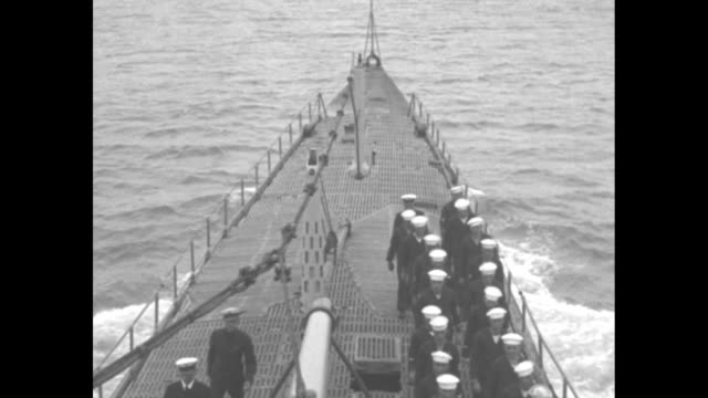 shot on board us navy submarine v-4 of crew on deck as submarine sails along / sailor standing on deck using signal flags to send message / note:... - us navy stock videos & royalty-free footage