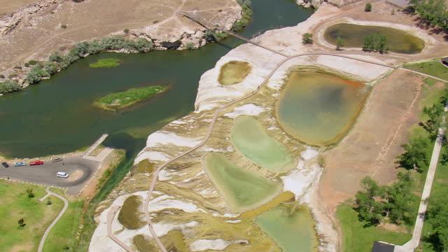 ws aerial zi shot over black sulphur springs / wyoming, united states - schwefelquellen stock-videos und b-roll-filmmaterial