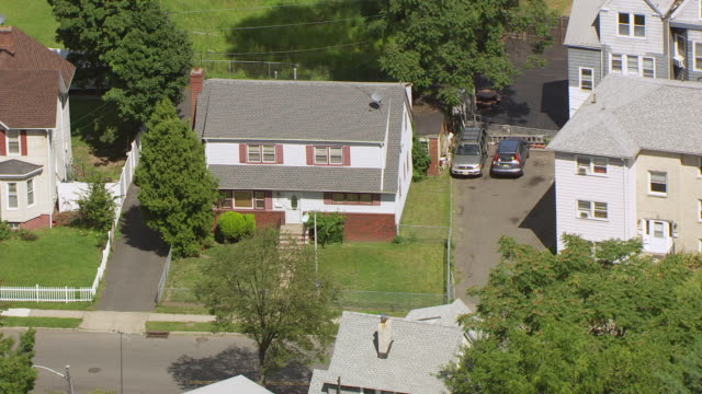 ms aerial shot over childhood home of whitney houston in east orange / new jersey, united states - whitney houston stock-videos und b-roll-filmmaterial