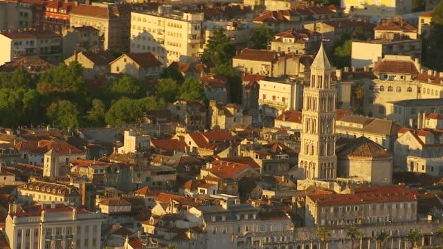 WS AERIAL Shot over church under yellow sunlight / Split, Split Dalmatia County, Croatia