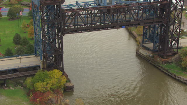 MS TU AERIAL Shot over Cuyahoga River to Calumet bulk carrier / Cleveland, Ohio, United States