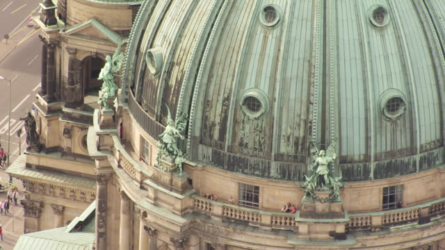 cu aerial tu shot over dome of collegiate church with people and cars moving on street / berlin, germany - catholicism stock videos & royalty-free footage