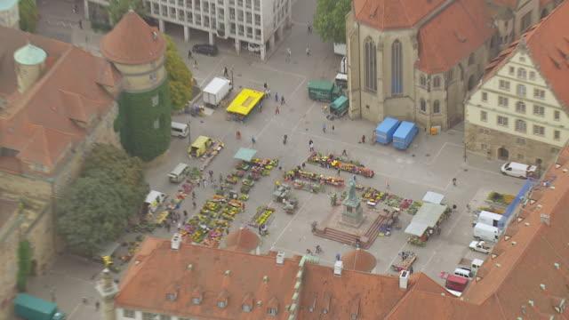 MS AERIAL ZO Shot over flower market and Altes schloss / Stuttgart, Baden Wurttemberg