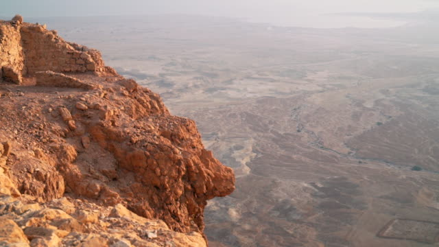 CU HA Shot over fortress walls at Masada and cliff looking out to desert floor and Dead Sea / Israel