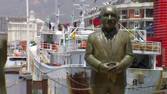 ms pan shot over four laureates of nobel square, at v&a waterfront / south africa - capital cities stock videos & royalty-free footage