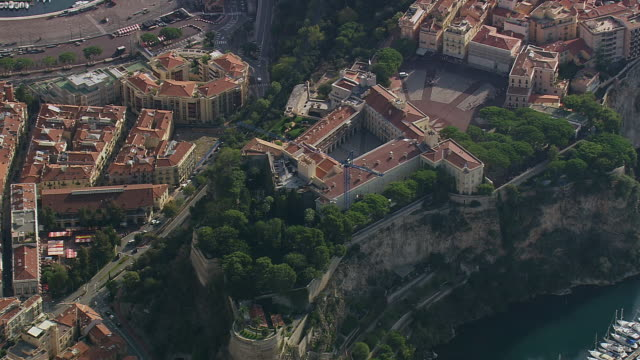 ws aerial shot over grimaldi palace / monaco, france - palace stock-videos und b-roll-filmmaterial