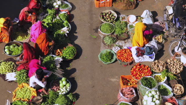 ms t/l shot over local vegetable market / pushkar, rajasthan, india - market trader stock videos & royalty-free footage