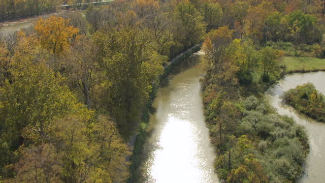 ws aerial shot over maumee river along old miami erie canal in providence metro park in wood county / ohio, united states - erie county ohio stock videos & royalty-free footage