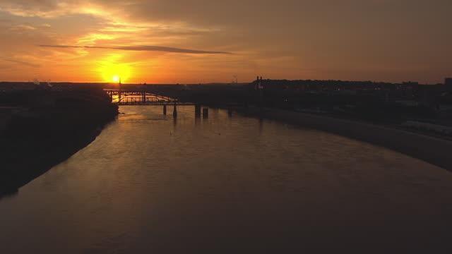 WS AERIAL Shot over Missouri River during sunrise / Kansas City, Missouri, United States