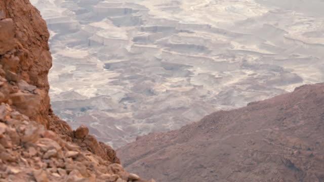 CU HA Shot over Negev desert with Masada fortress ruins / Israel