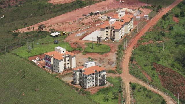 WS AERIAL Shot over newly construct buildings / Minas, Gerais Brazil