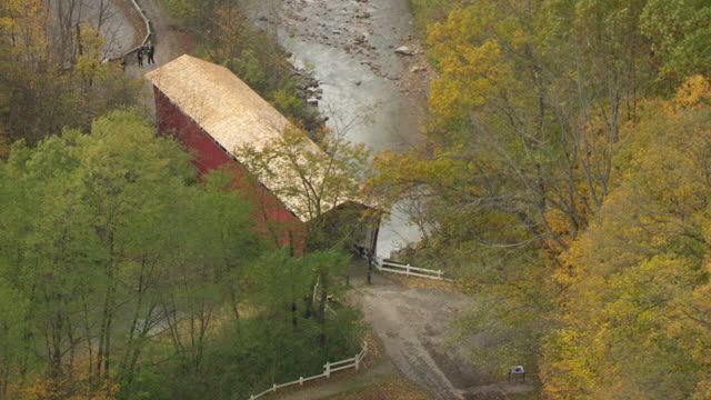 MS DS AERIAL Shot over old red covering bridge in Cuyahoga Valley National Park / Ohio, United States