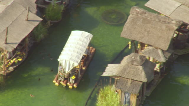 ms aerial shot over paddle boat and small hut in largest theme euro park / rust, baden wurttemberg, germany - paddle boat stock videos & royalty-free footage