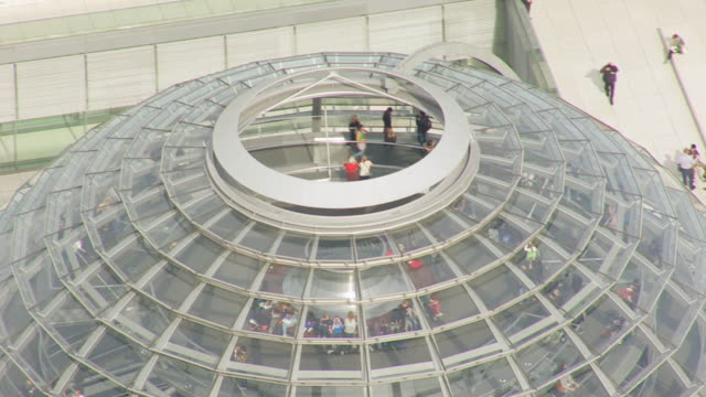 ms aerial shot over people inside of dome of reichstag building / berlin, germany - cupola video stock e b–roll