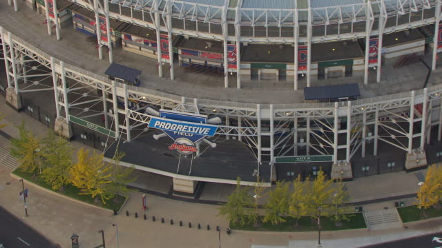 ms zo aerial shot over progressive field sign outside and stadium / cleveland, ohio, united states - cleveland stock videos and b-roll footage