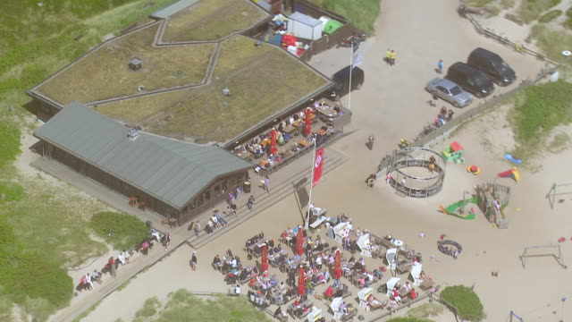 ms aerial ds zo shot over restaurant at coast of sky island / sylt, schleswig holstein - sylt stock videos & royalty-free footage