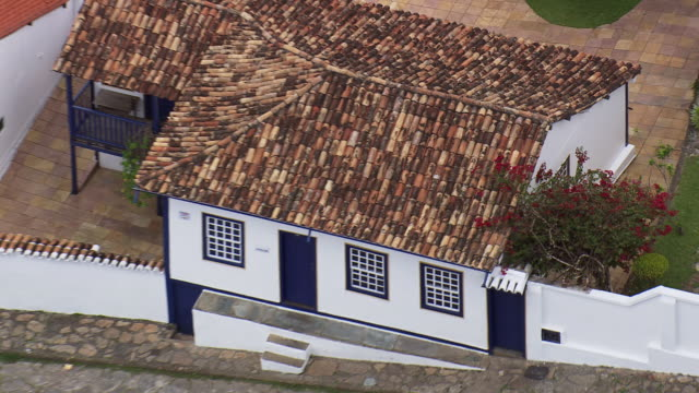 cu aerial zo shot over roof tops, diamantina / minas gerais, brazil - minas stock videos and b-roll footage