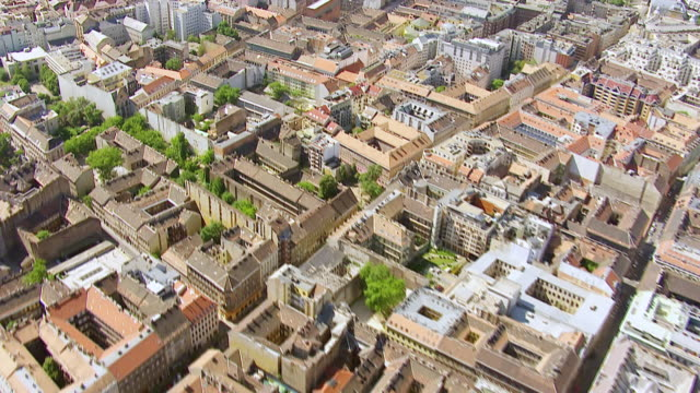 MS AERIAL Shot over roof tops of buildings in city / Budapest, Hungary