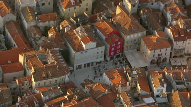 MS AERIAL Shot over roof tops / Split, Split Dalmatia County, Croatia