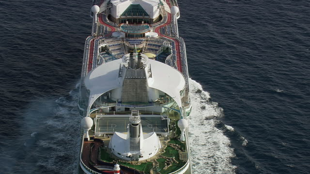 WS AERIAL Shot over Royal Caribbean Cruise running on sea surface / Provence Alpes Cote d'Azur, France