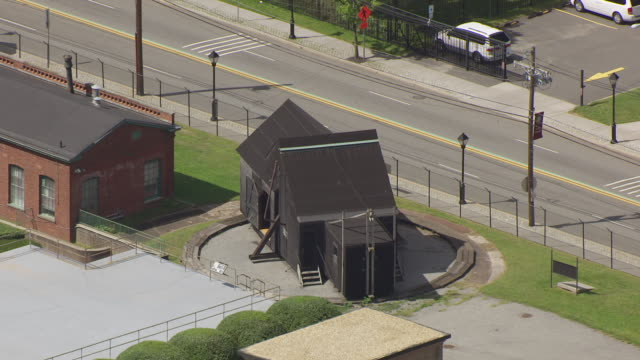 MS AERIAL Shot over small building at Edison National Historic Park in West Orange County / Edison, New Jersey, United States