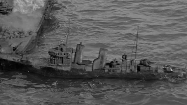 ms td tu shot over submarines in ocean in battle, smoke and fire from wrecked ships - krieg stock-videos und b-roll-filmmaterial