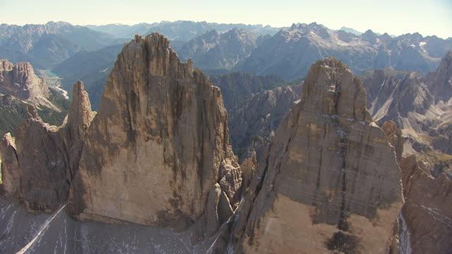 ms aerial ds shot over three peaks of lavaredo in sexten dolomites / drei zinnen, belluno sudtirol - tre cimo di lavaredo stock videos & royalty-free footage