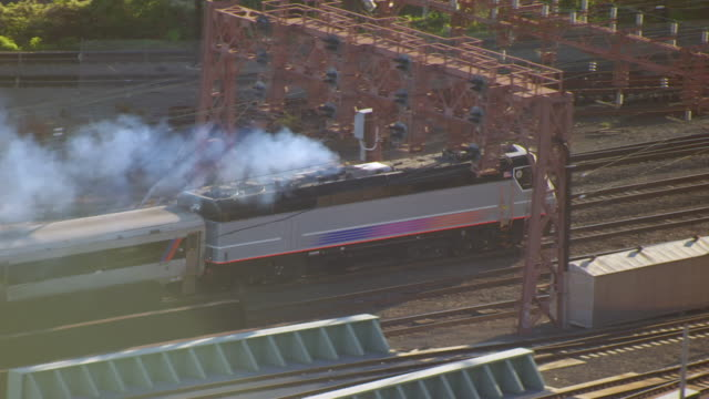 MS AERIAL TS Shot over train leaving Eerie Lackawanna terminal / Hoboken, New Jersey, United States