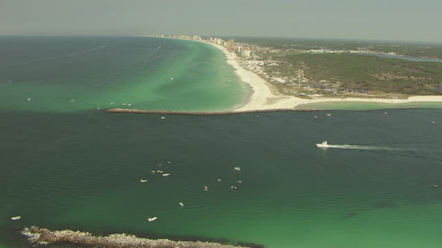 WS AERIAL TD Shot over water and jetties Panama City / Panama City, Florida, United States