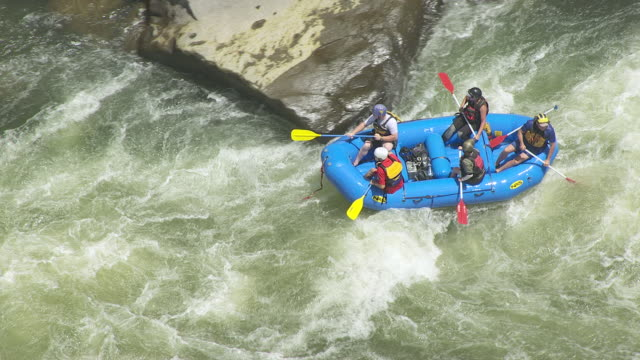 ms ts aerial shot over white water rafters maneuvering through lost paddle rapids of gauley river / west virginia, united states - whitewater rafting stock videos & royalty-free footage