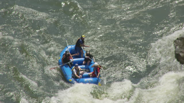 ms ts aerial shot over white water rafters maneuvering through lost paddle rapids in gauley river / west virginia, united states - whitewater rafting stock videos & royalty-free footage