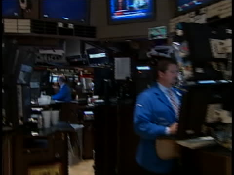 vídeos y material grabado en eventos de stock de shot pans down from big board of the new york stock exchange to a trader working on the floor of the nyse. - business or economy or employment and labor or financial market or finance or agriculture