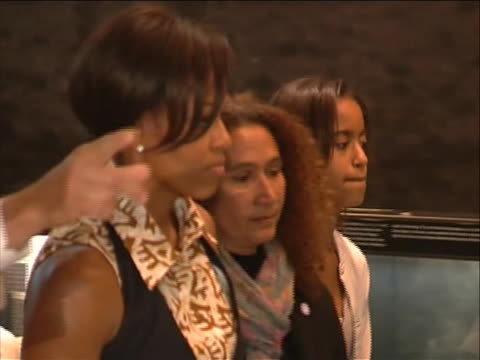 shot pans right to follow first lady michelle obama as she walks through the apartheid museum in johannesburg, south africa. at the time of her june... - ハウテング州点の映像素材/bロール