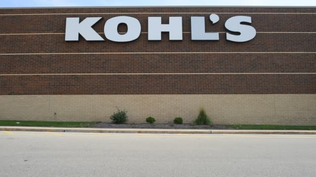 shot pans up to a kohls sign above the maine entrance to their store in peoria illinois exterior shots of kohl's signage mounted on the side of their... - kohls stock videos & royalty-free footage