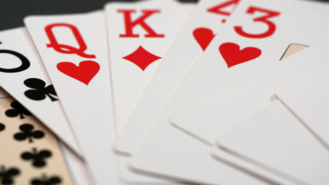 ecu shot playing cards on table - poker stock-videos und b-roll-filmmaterial