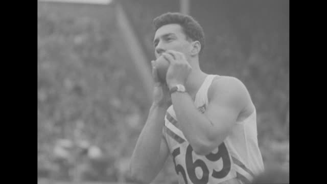 shot put competition in progress at summer olympics in london / shot approaches camera after american jim delaney throws it / vs american jim fuchs,... - shot put stock videos & royalty-free footage