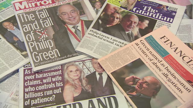 vidéos et rushes de shot showing a collection of british newspapers with sir phllip green on the front page - editorial
