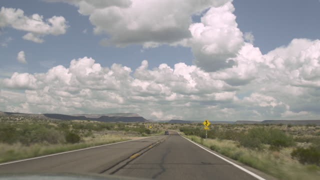 POV shot showing a straight section of road, western USA.
