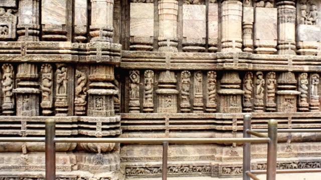 ms pan shot showing details of carved statues at hindu konark sun temple / puri, orissa, india - female likeness stock videos & royalty-free footage