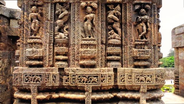 ms tu shot showing details of carved statues at hindu konark sun temple / puri, orissa, india - weibliche figur stock-videos und b-roll-filmmaterial